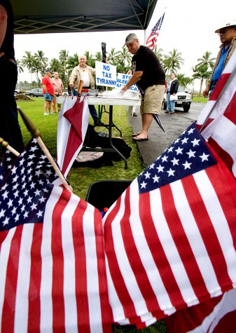 Organizers passed out flags and signs for the Tax Day Tea Party in Hilo. Photography by Baron Sekiya/Hawaii247.com