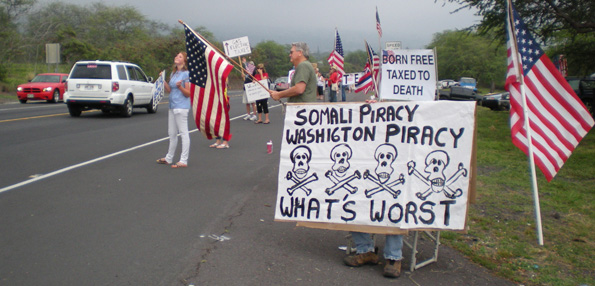 More than 100 people turned out Wednesday in Kona for the Tax Day Tea Party. (Hawaii247.com photo by Karin Stanton)