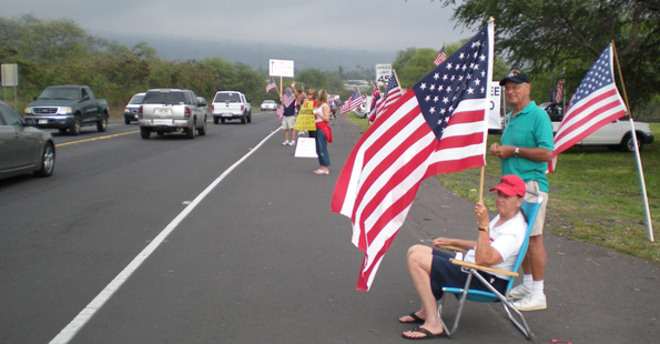 Claire Eddo displays her patriotism Wednesday in Kona for the Tax Day Tea Party. (Hawaii247.com photo by Karin Stanton)