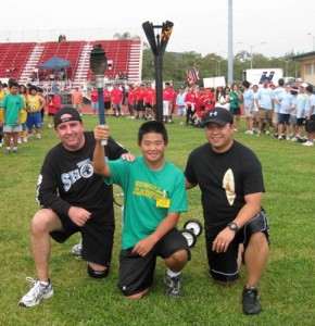 Officer Jason Grouns, Special Olympics Athlete Shawn Ono, and Officer Joseph Rocha.
