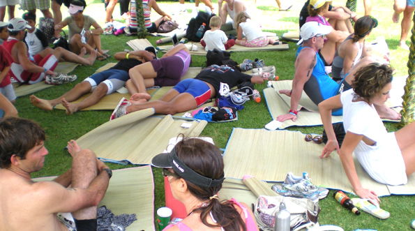 Athletes take avdantage of the shade under a tent at the finish line. (Hawaii247.com photo by Karin Stanton)