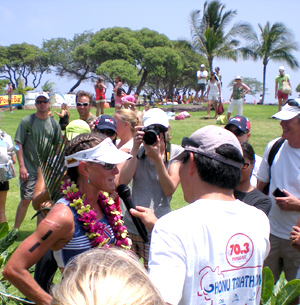 Belinda Granger gives a finish line interview after scoring the Ironman 70.3 Hawaii title Saturday. (Hawaii247.com photo by Karin Stanton)
