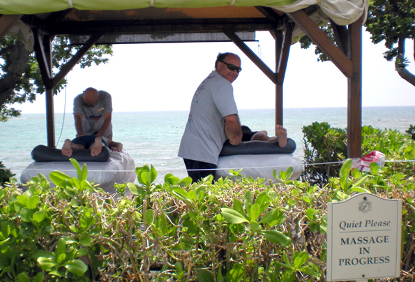 Volunteers offered massages oceanside. (Hawaii247.com photo by Karin Stanton)