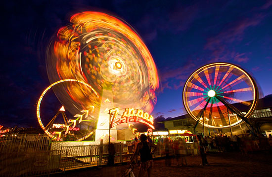 The lights of the E.K. Fernandez rides light-up Hilo for the Hawaii County Fair at Victor Wong Stadium.