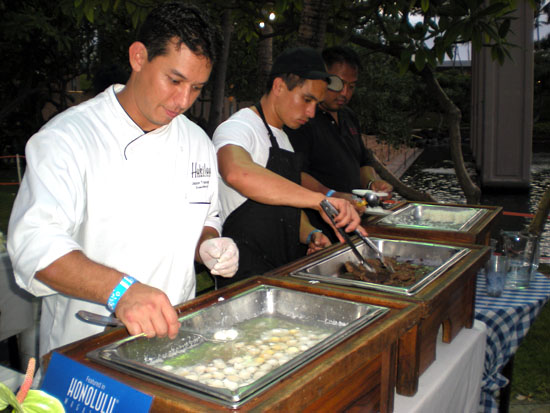 Serving up a beef dish with quail eggs from Hukilau Honolulu and Chef Jason Takemura.