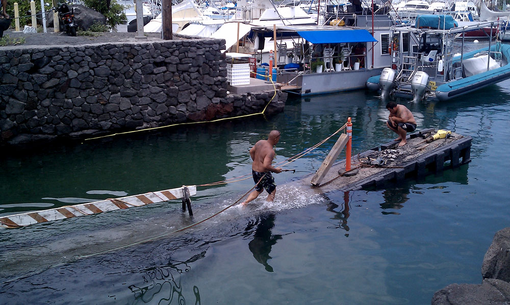 The makai boat ramp dock at Honokohau Small Boat Harbor collapsed Sunday morning (May 23).