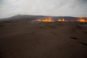 View looking along recently opened fissure segment crossing tephra flats southwest of Pu'u 'Ō 'ō, which is in the background Saturday (March 5).
