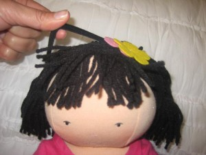 Remove the headband of the Audrey doll to remove the hazard.