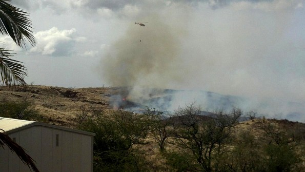The Fire Department's Chopper Two uses a Bambi Bucket to perform water drops on a fire near Waikoloa Village. Photo by Bonnie Palos | Special to Hawaii 24/7