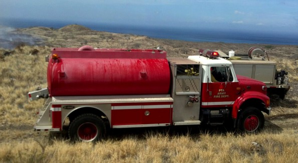 A water tanker from Pohakuloa Training Area joins County fire crews battling the blaze. Photo by Bonnie Palos | Special to Hawaii 24/7