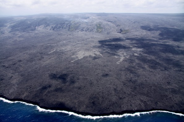 The lava flows on the coastal plain are still slowly advancing towards the water. On the Monday (May 21) overflight, the active breakouts were about 750 m (0.5 miles) from the ocean. These flows have once again entered the National Park. Photo courtesy of USGS/HVO