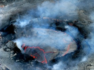 A circular lava pond has recently been active near the eastern rim of Pu'u 'O'o crater. Monday (May 21), the lava pond had a low-level but continuous spattering from its eastern margin, and a mostly crusted lava surface. Photo courtesy of USGS/HVO