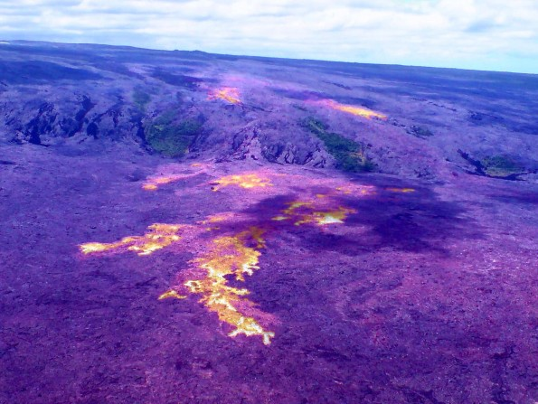 Lava flows remain active on the pali and coastal plain, and continue to slowly migrate towards the ocean. This thermal-visual composite shows the distribution of active flows, which are extensive and consist of several lobes. The active flow front Friday (June 15) was 1.1 km (0.7 miles) from the ocean. Photo courtesy of USGS/HVO