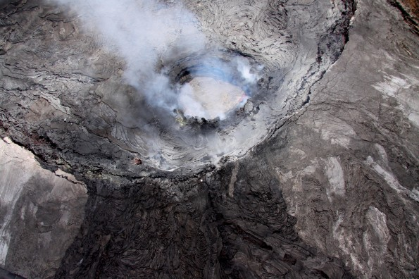A close-up of the lava pond in the eastern portion of Pu'u 'O'o crater Friday (June 15). The lava pond is about 30 meters (100 ft) in diameter. The dark lava flows at the bottom of the photo are crater overflows that swept down the east flank of Pu'u 'O'o in September 2011. Photo courtesy of USGS/HVO