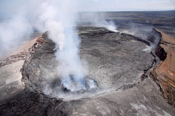 View of Pu'u 'O'o crater, looking Southwest Friday (June 15). In the foreground, an active, spattering lava pond is contained within a collapse pit near the east rim of the crater. Two additional vents, both emitting fume, can be seen behind the fume from the lava pond. Photo courtesy of USGS/HVO