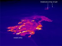 This thermal image shows the scattered breakouts on the coastal plain and the ocean entry near Kupapa`u. In addition to these coastal plain flows, several breakouts were active near the top of the pali, around the northern boundary of Royal Gardens subdivision. Photo courtesy of USGS/HVO