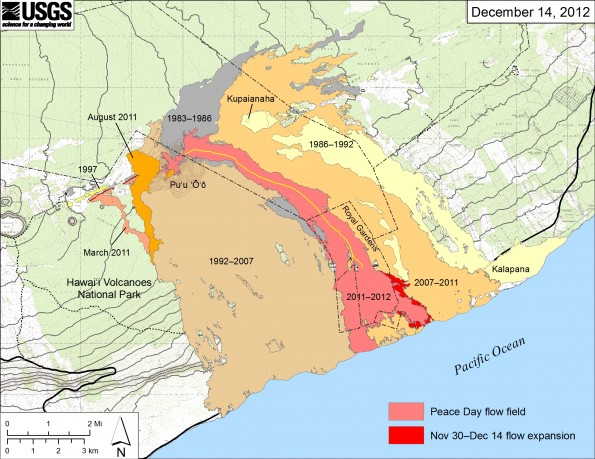 Map showing the extent of lava flows erupted during Kīlauea's ongoing east rift zone eruption and labeled with the years in which they were active. Episodes 1–48b (1983–1986) are shown in gray; episodes 48c–49 (1986–1992) are pale yellow; episodes 50–53 and 55 (1992–2007) are tan; episode 54 (1997) is yellow; episode 58 (2007–2011) is pale orange; the episode 59 Kamoamoa eruption (March 2011) is at left in light reddish orange; and the episode 60 Puʻu ʻŌʻō overflows and flank breakout (Mar–August 2011) are orange. The currently active Peace Day flow (episode 61) is shown as the two shades of red—light red is the extent of the flow from September 21, 2011, to November 30, 2012, and bright red marks the mapped flow expansion from November 30 to December 14. There may have been minor flow margin changes upslope, in and above the upper part of Royal Gardens, which have not been mapped and are not shown on this map. The active lava tube is delineated by the yellow line within the active flow field. Incipient tubes extend onto the coastal plain to feed the currently active flows, but these have not been mapped. The contour interval for topographic lines shown on Puʻu ʻŌʻō is 5 m.