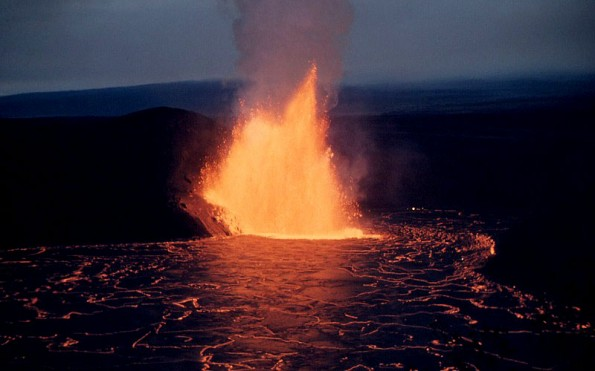 A lava fountain from the base of Pu`u Pua`i cone feeds a lava lake in Kilauea Iki Crater.  Photo taken on December 5, 1959. Photo courtesy of USGS/HVO