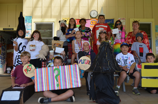 Parker School fifth graders stand with their teacher Mrs. Weiser after their vocabulary parade in February. (Photo courtesy of Parker School)
