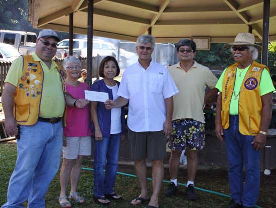 (From left) Kona Lions Club President Joey Gusman; WHCHC Board of Directors member Joan Gannon, WHCHC Board of Directors President Terri Toki; WHCHC Executive Director Richard Taaffe; WHCHC Board of Directors member Mike Matsukawa; Past International Director and Lions Club of Kona Officer Maurice Kahawaii. (Photo courtesy of Lions Club)