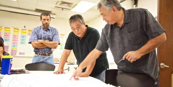 Hawaii Electric Light Company President Jay Ignacio, right, works with fellow HELCO staff on coordinating power recovery efforts on August 13, 2014. Photo courtesy of HECO.