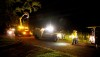 A Hawaiian Electric crew works late at night in Hawaiian Paradise Park restoring power to homes for residents. Photography by Baron Sekiya | Hawaii 24/7