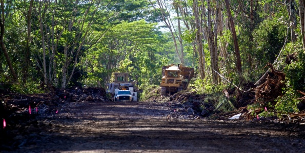 Crews are using heavy equipment to improve Railroad Avenue near Hawaiian Beaches Subdivision Saturday (Sept 13) as they prepare an alternate route for Puna traffic in the event of Highway 130 being breeched by a lava flow. Photography by Baron Sekiya | Hawaii 24/7