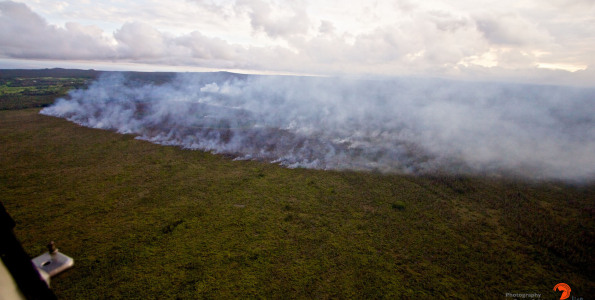 A brushfire sparked by the the Kilauea June 27th Lava Flow is burning vegetation ahead of the flow front Saturday (Sept 20). Winds are pushing the smoke North over a large area. Photography by Baron Sekiya | Hawaii 24/7, Air Transportation by Paradise Helicopters