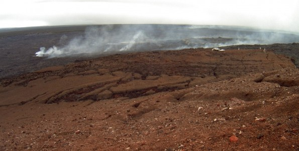 The steaming top of the lava tube system at Pu'u 'O'o crater on the North flank. Image taken at 7:39 a.m. HST, Wednesday, October 15, 2014. Photo courtesy of USGS/HVO