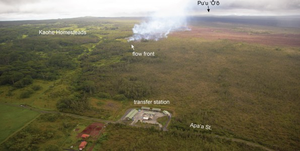 The June 27th lava flow advancement has slowed, with the leading edge of the flow moving only a few tens of meters (yards) over the past two days. Nevertheless, active breakouts persist around the flow front, as shown in this photo, taken on Wednesday, October 15, 2014, by the continued burning of vegetation along the flow margins. This morning, the flow front was 1.1 km (0.7 miles) from Apaʻa St., as measured along a straight line. Photo courtesy of USGS/HVO