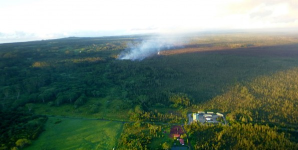 The Kilauea June 27th Lava Flow with the Pahoa Transfer Station in the foreground. Image taken October 21, 2014. Photo courtesy of Hawaii County Civil Defense