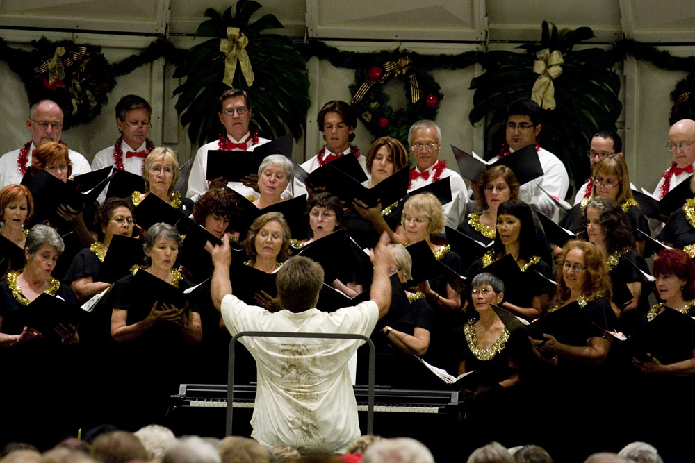 Director Mark Barville conducts the Kona Music Society Chorus during a performance at the Sheraton Keauhou Bay Resort Sunday evening.