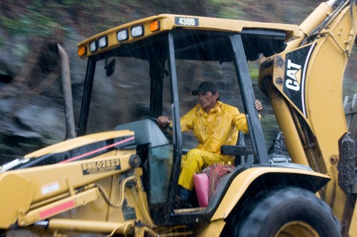 Road crews worked to keep the highways clear of debris during the heavy rain which hit the Kona area Thursday.