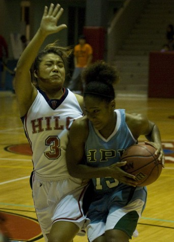 Hawaii Pacific's Paris Gravely (15) right, drives past UH-Hilo Vulcan Kayce Kirihara (3) during action Friday night in Hilo.