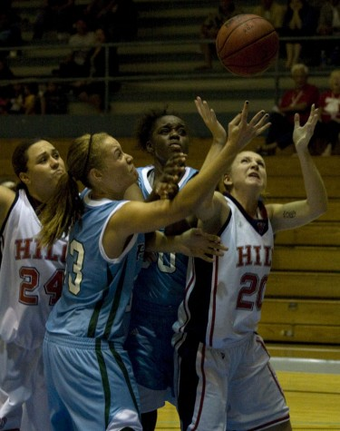 Sheila Azevedo (24), Angel Spence (33), Genesis Lewis and Amanda Adams (20) battle under the UH-Hilo basket for a rebound during women's basketball at Afook-Chinen Civic Auditorium.