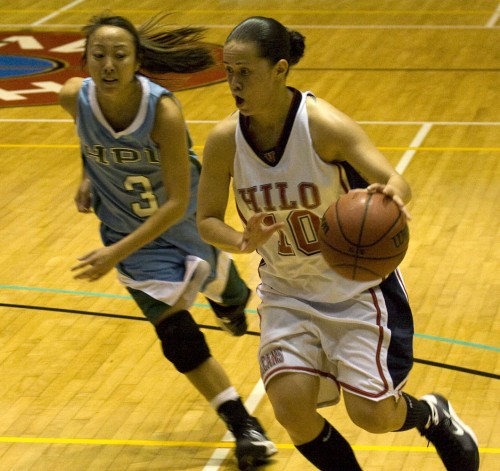 UH-Hilo Vulcan Ashley Kualii (10) is up against Hawaii Pacific University's Mackenna Karasawa (3) during college basketball action in Hilo.