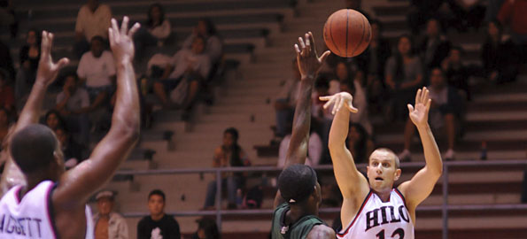 UH-Hilo's Jacob Briggs (13) shoots over an HPU player during action at the Hilo Civic Auditorium.
