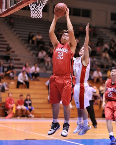 HPA's Keita Kiyomitsu goes high for a rebound over St. Joseph's Jacob Andrade.