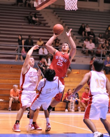 HPA's Keoki Phillips charges to the hoop over St. Joseph's Royden Masulit.