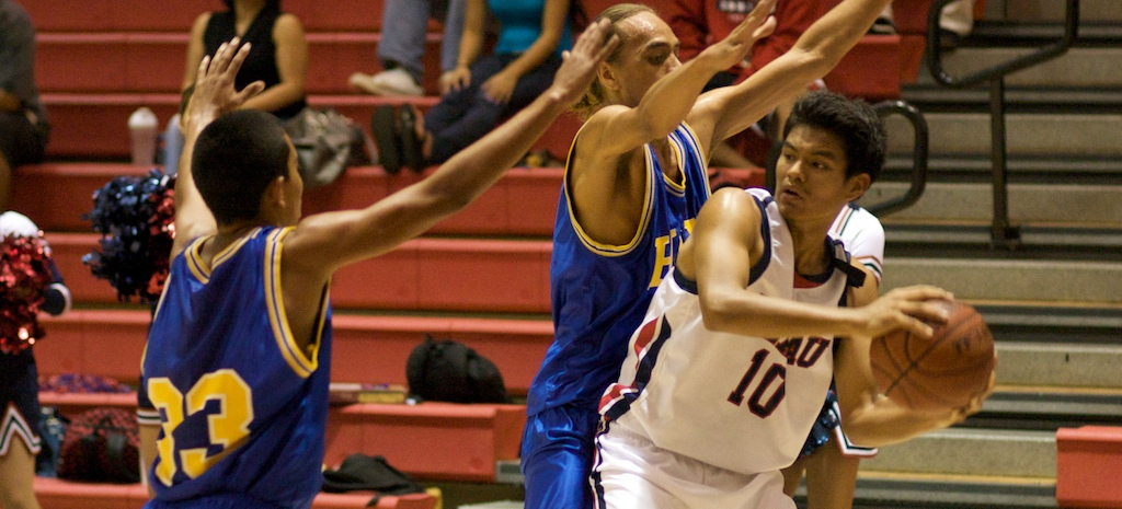 Keaau Cougar Richard Handy (10) is surrounded by a pair of Hilo Vikings during first quarter action at Keaau High School Gym. Keaau wins 66-63. Click above for photos and video.
