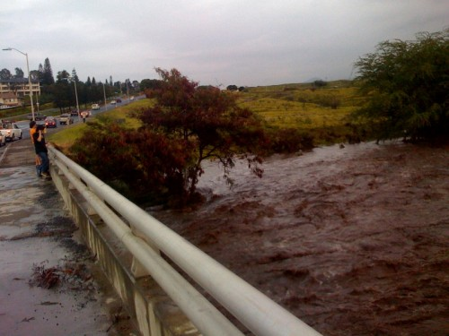 Auwaiakeakua Gulch, near Waikoloa Village, spills over Waikoloa Road as heavy rains soaked the west side of the island. The forecast for Wednesday night is for scattered showers with a chance of thunderstorms, clearing after midnight. The National Weather Service forecasts more thunderstorms possible for Thursday afternoon.