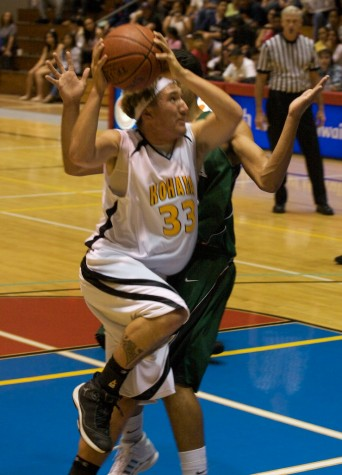 Kohala's Kapanaia Carvalho (3) goes to the hoop during BIIF Div-II  finals action.