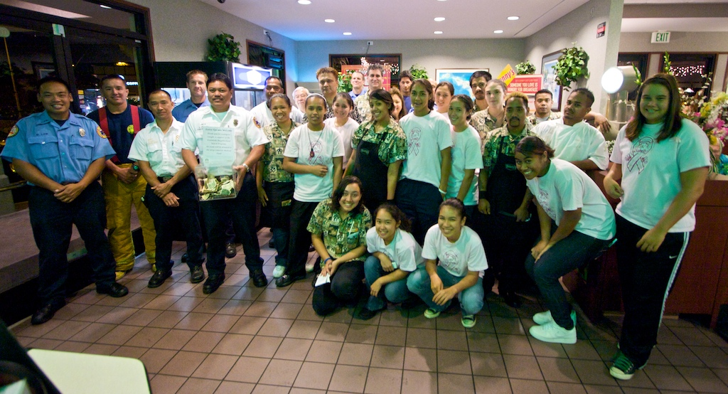 Volunteers and workers participating in Project Compassion at Denny's restaurant in Kona.