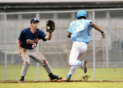 Close play at first base. The Waverider's Tyson Pierceswift was called safe just as the Cougars' Matthew Vidinha caught the ball.