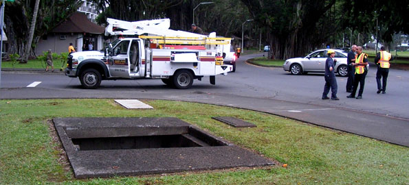 Fire, police and HELCO crews responded to Banyan Drive when an explosion blew open a 6x7 foot concrete and metal cover off a manhole. The explosion knocked out power to hotels and businesses in the area.