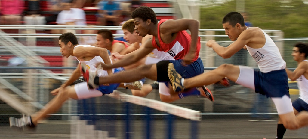 Boys fly through the 110 meter hurdles at Keaau during a BIIF track and field meet. Click on above image for photos, video and full results.