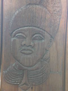 The artwork engraved in the wooden fence has been restored.