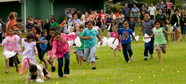 Kids take-off at Hawaiian Beaches Park for the Easter Egg Hunt Wednesday afternoon.