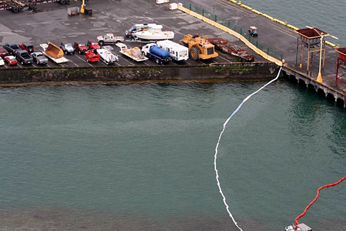 U.S. Coast Guard investigators from Marine Safety Detachment, Hawaii, on the Big Island, responded Thursday and Friday to a small oil spill in Hilo Harbor. This photo was taken Thursday, April 9, 2009, by the crew of an HH-65 Dolphin rescue helicopter.