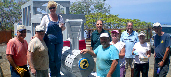 A beautiful day in Kona with volunteers putting a new finish on the playground Saturday.